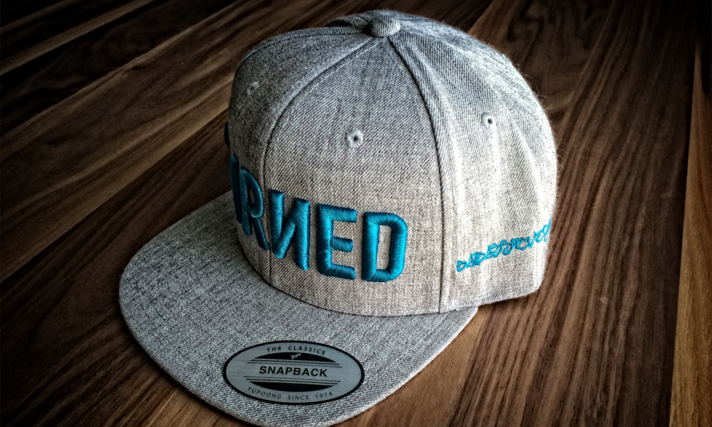 EARNED AQUA SNAPBACK SIDE.png
