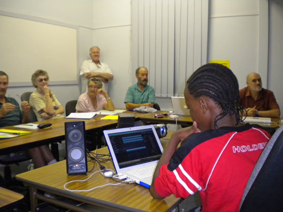 Kenneth (Year 7) tutoring some more experienced Mac users in the art of Garageband (Photo M. Jesser).