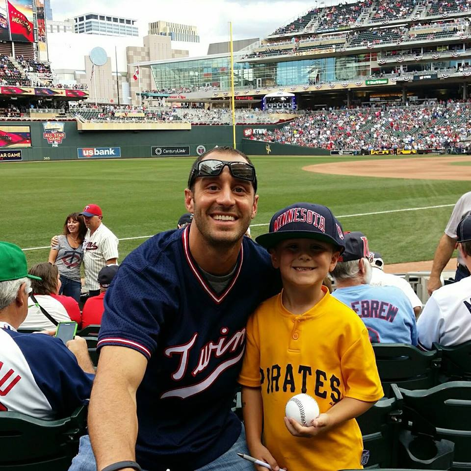 Jason attending the 2014 All-Star Game at Target Field with his son Garrett.