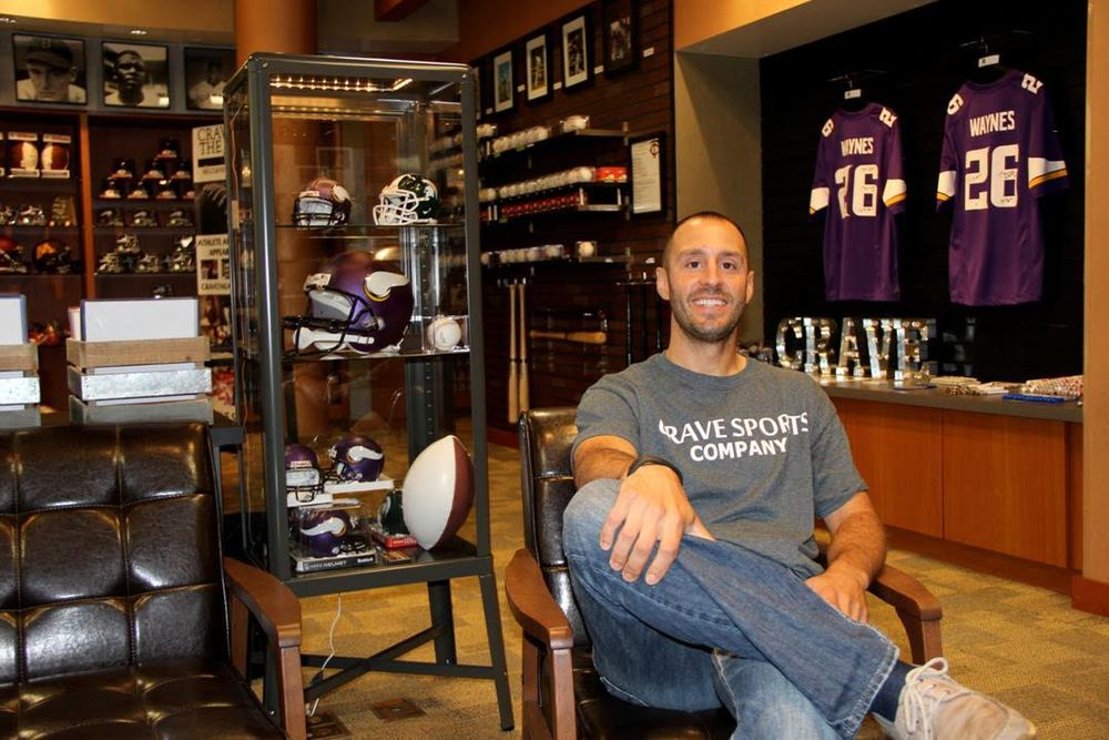 Jason Hostetler, relaxes in Crave Sports, an autograph signing store he opened in Southdale July 2015. Photo by Sue Austreng
