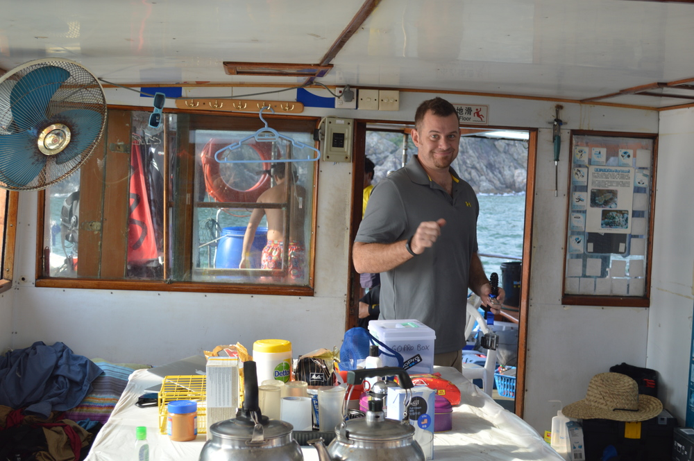 Dave Baker on a junk boat in Hong Kong