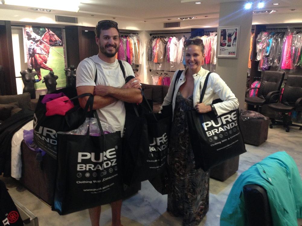 Amber and Karl collect their PURE apparel before their trip to New Zealand