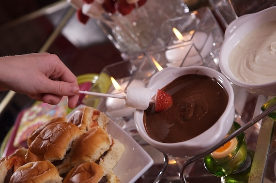 FONDUE IS FUN-DO! WHITE AND DARK CHOCOLATE FONDUE IS SIMPLE AND DECADENT. DIP FRUIT, MARSHMALLOWS, OR BITES OF CAKE, ETC