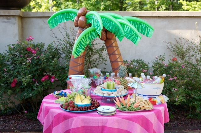 Order retro cool pool party decor from Oriental Trading Company. Add an oversized striped beach towel as a tablecloth to make decorating easy.