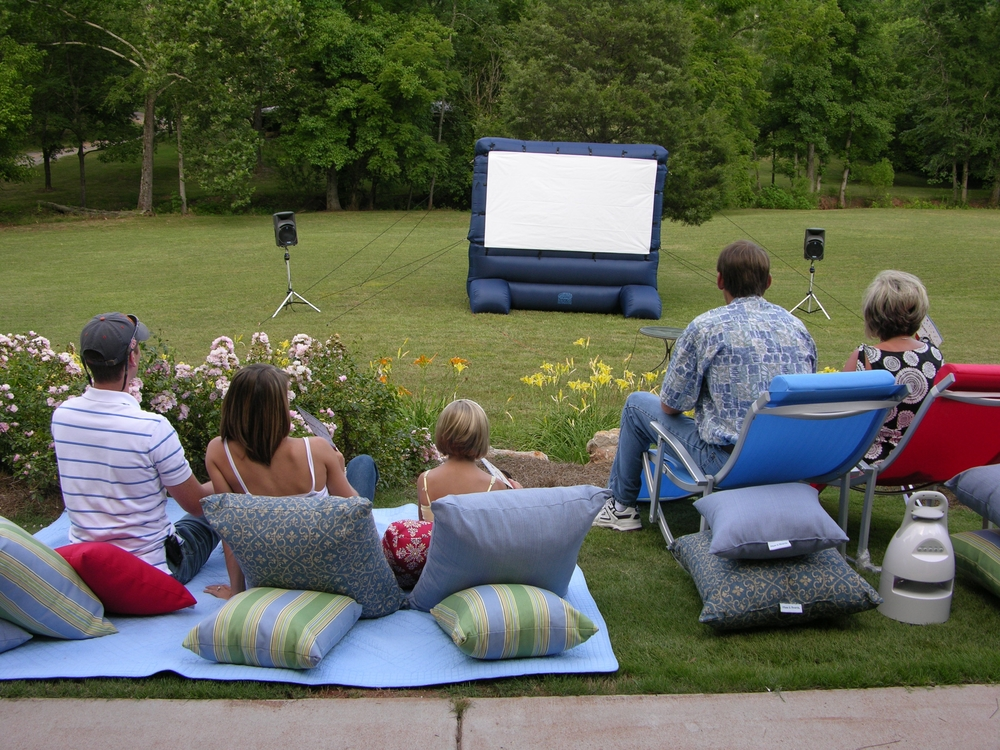 Using an inflatable movie screen to show movies out on the lawn is one of summer's best party ideas!