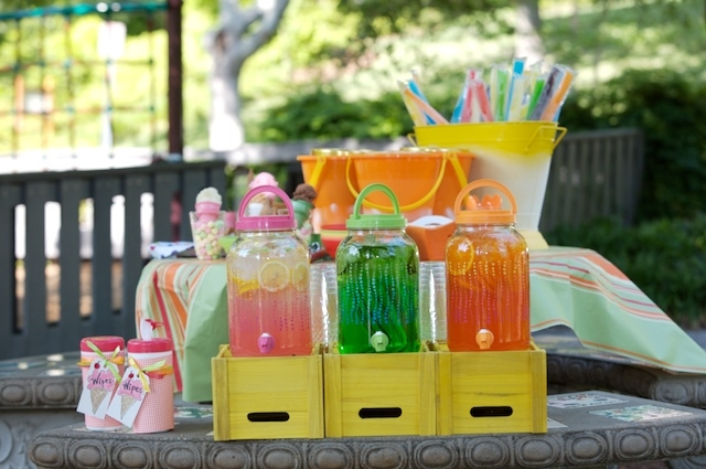 Cheap plastic dispensers filled with Kool-Aid or flavored water infused with sliced fruit looks pretty and keeps kids hydrated.