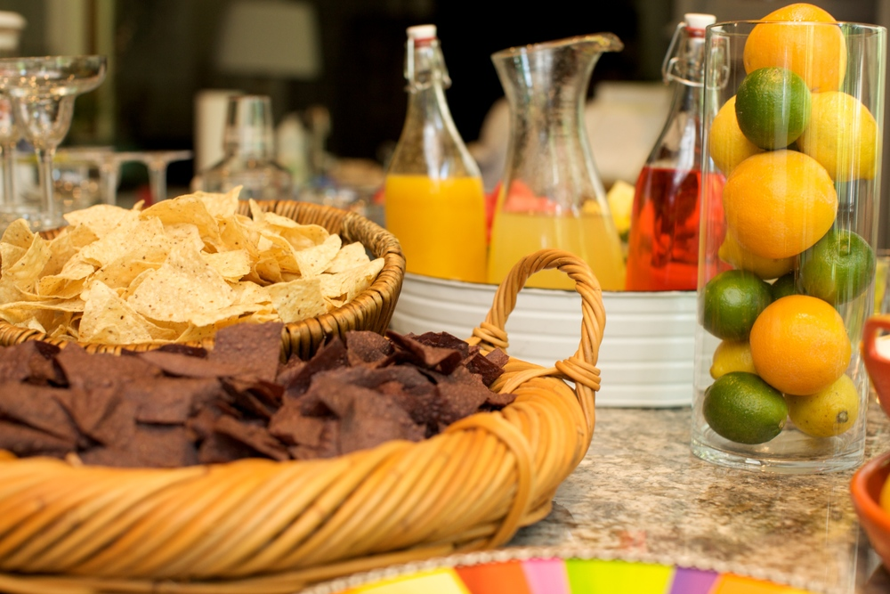 Use your food and beverages as decorations for this party. Mix in a few bright items in fiesta shades or some paper plates and napkins in a Mexican fiesta theme and you're set.