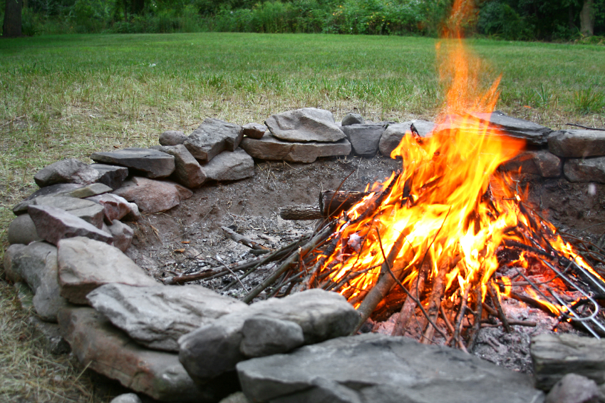 Have a designated area for your fire and make sure to follow all of Smokey Bear's rules for fire safety and keep a hose or bucket of water handy.