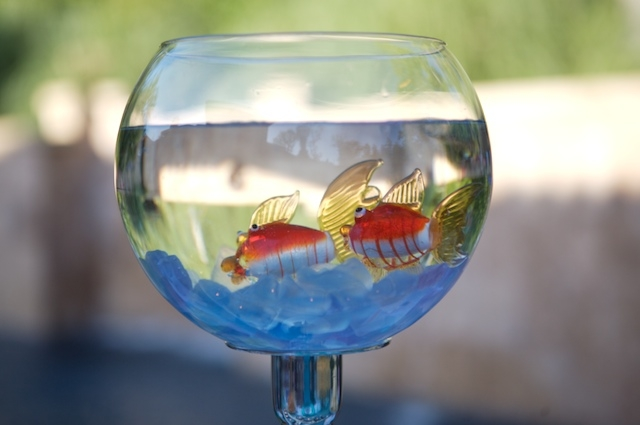 These guys almost look real but they are pretty, inexpensive glass fish that you might find at an aquarium store. I found these at Pier 1. Sit them on top of ocean colored sea glass for a lovely change to a flower centerpiece.