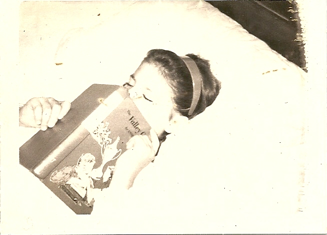 Martie reading in bed.jpg