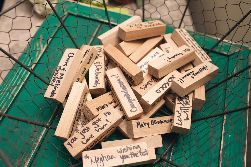 Jenga blocks are signed by wedding guests as guest book
