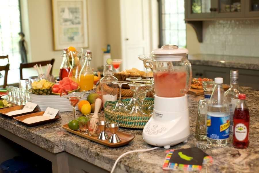 Easy and fun: make a Margarita station with fresh fruit and a rimming station.