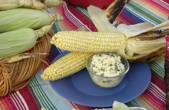 Easy and always perfect grilled corn with compound butter of lime, queso, and cilantro.