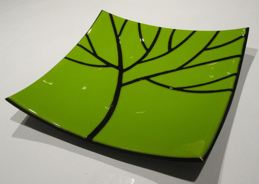 black tree on green platter