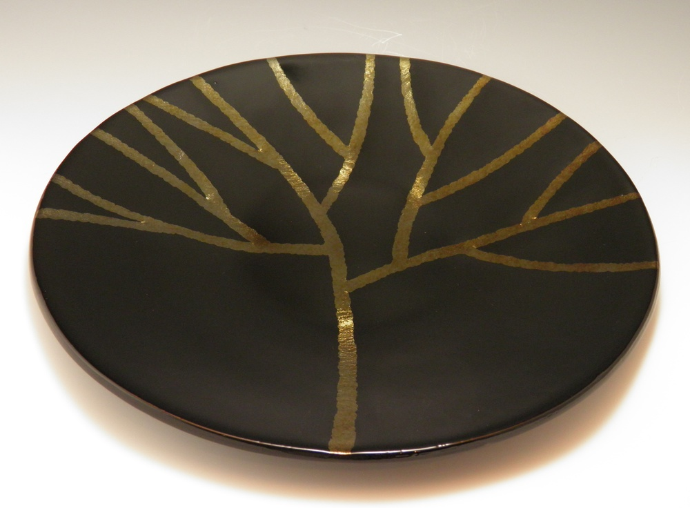 gold iridescent tree on black platter