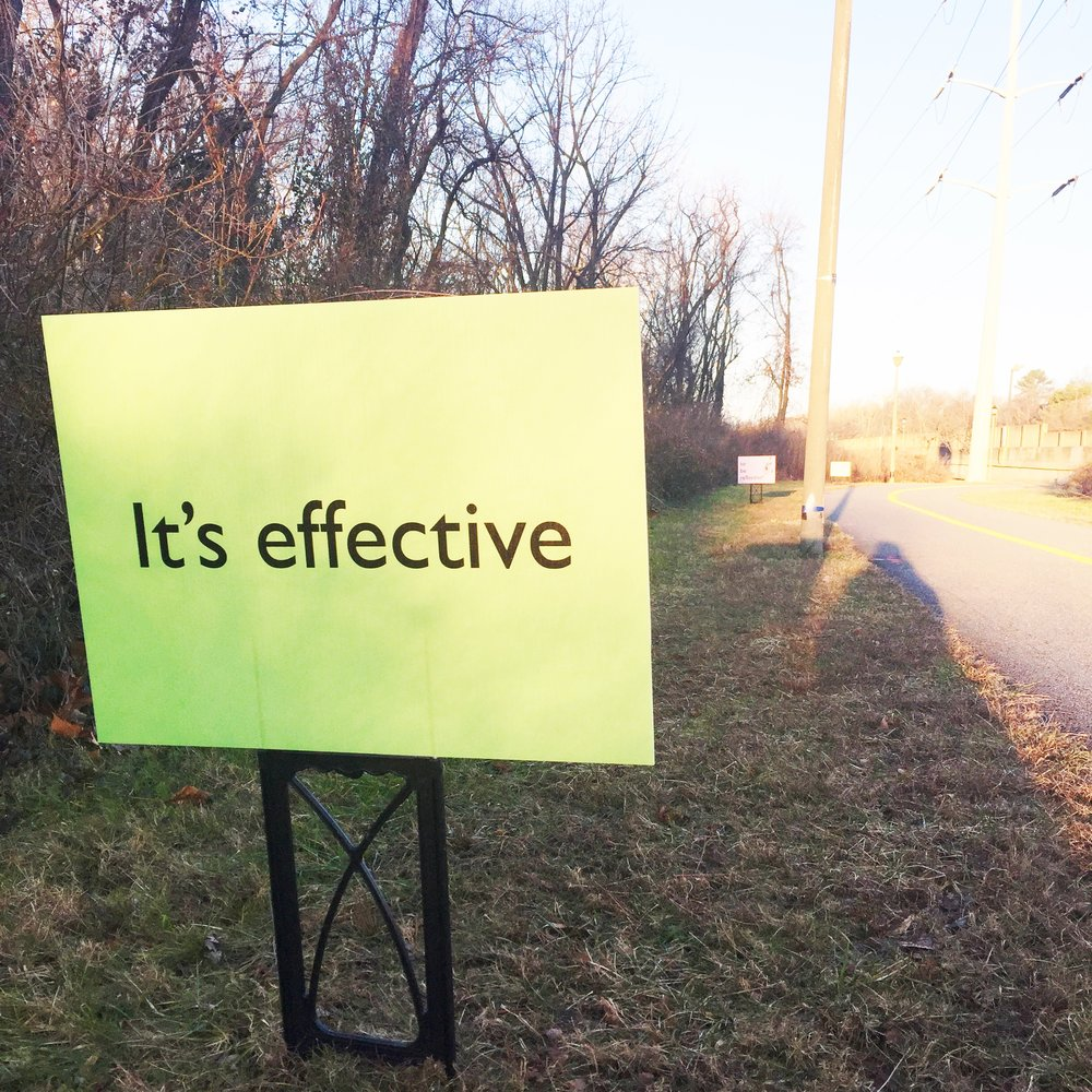 "Spotted on the WO&D: ""It's effective...to be reflective."" The signs are there to encourage cyclists to wear reflective clothing for safety when riding at night. The double-meaning gave me something to think about on my chilly 7-miler yesterday."
