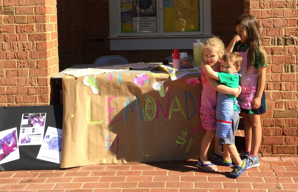 kids setting up lemonade stand, robin camarote