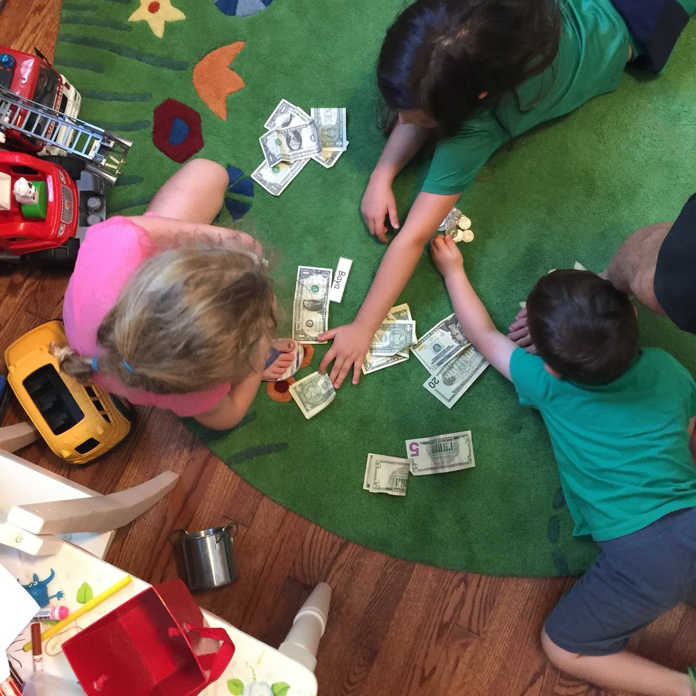 The kids counting their earnings.