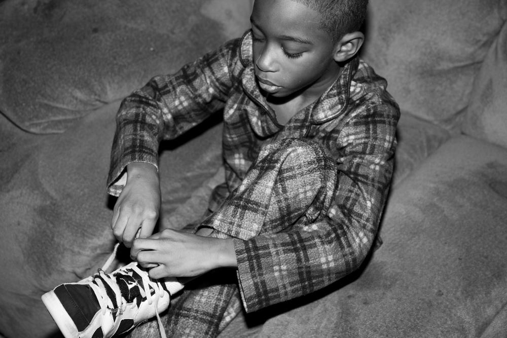 raymond ties his shoes.jpg