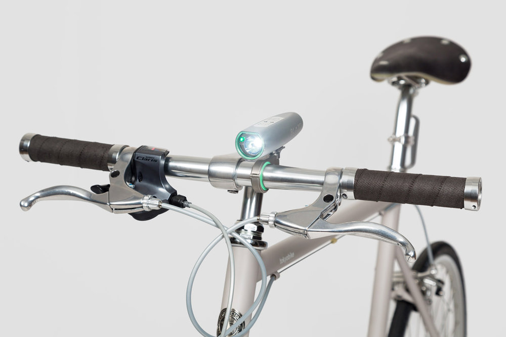 B    laze - Laserlight    Made with an aircraft grade aluminum casing, this powerful and waterproof light is sure to pave the way through evening rush hour. In addition to being a powerful 300 lumens, the Blaze projects a laser beam to alert traffic of an oncoming bicycle.   $200