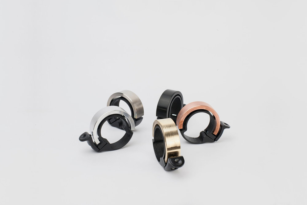 Knog Oi Bell The Knog Oi bell is designed to seamlessly blend with your handlebar, reducing the bulk of a traditional cycling bell. The convex shape of these little bells directs sound forward with a bright, and almost even  polite sounding resonance.  $20