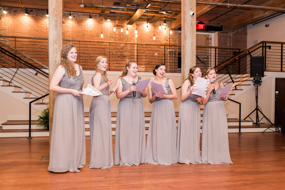 "Both Jimmy and Nicole work for the YMCA, so all of the bridesmaids surprised them during their toasts with a song all about their relationship to the tune of ""YMCA!"""