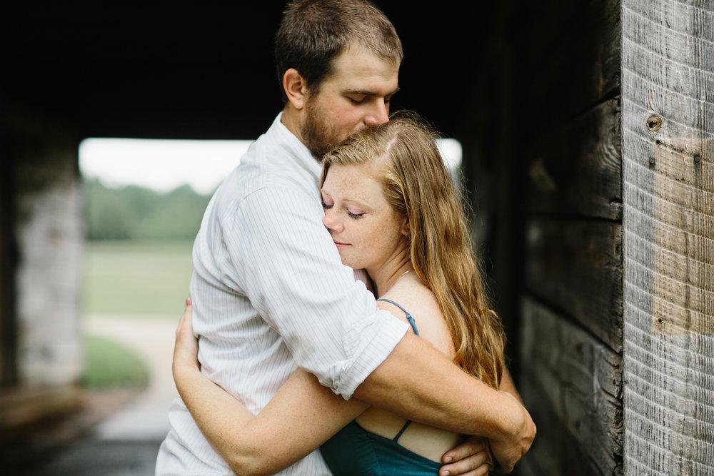 couple hugging.couple in love.e carroll joyner park.wake forest photographer.raleigh photographer.JPG