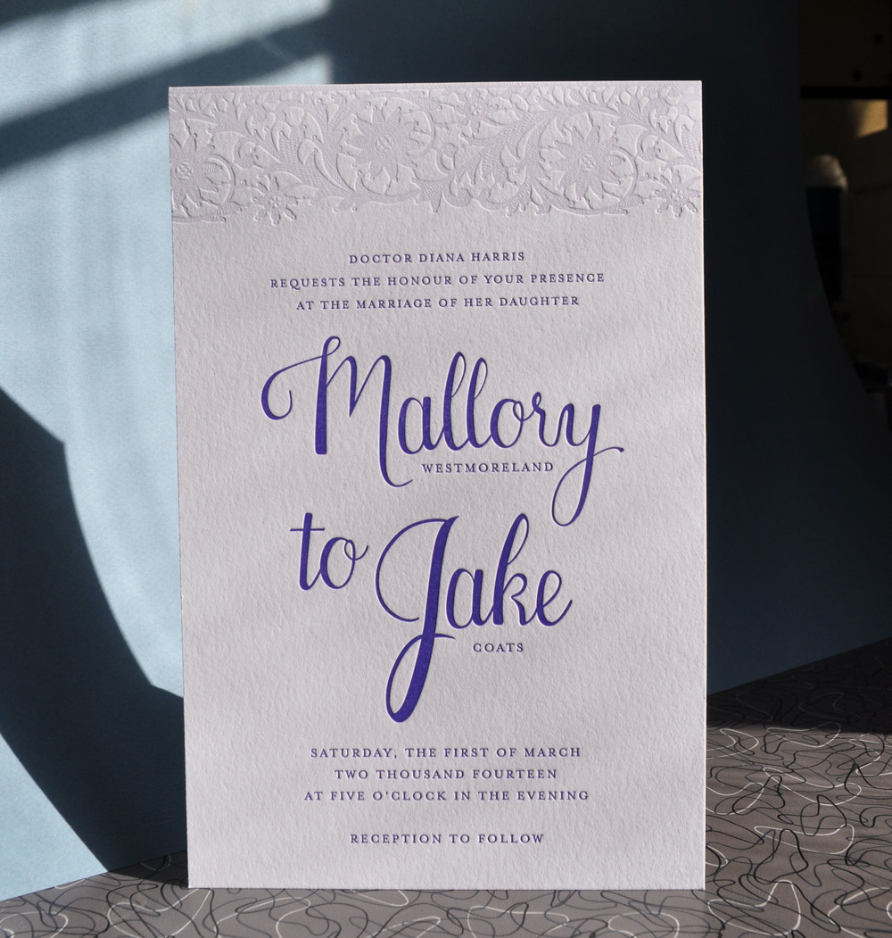 Modern calligraphy with pale lavender lace, designed by the bride