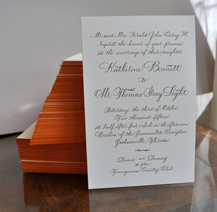 Elegant calligraphy wedding suite. Printed 1 color on double thick lettra with a parchment leaf, wrapped with twine and sealed with a wax monogram. Custom matching envelopes, inner and outer.