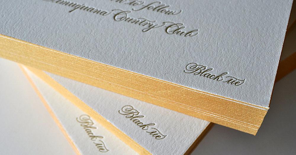 Gold edges for a swanky letterpress wedding invitation