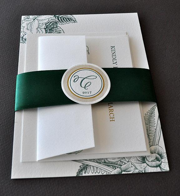 Elegant botanical theme for letterpress wedding invitation suite with band and monogram medalion