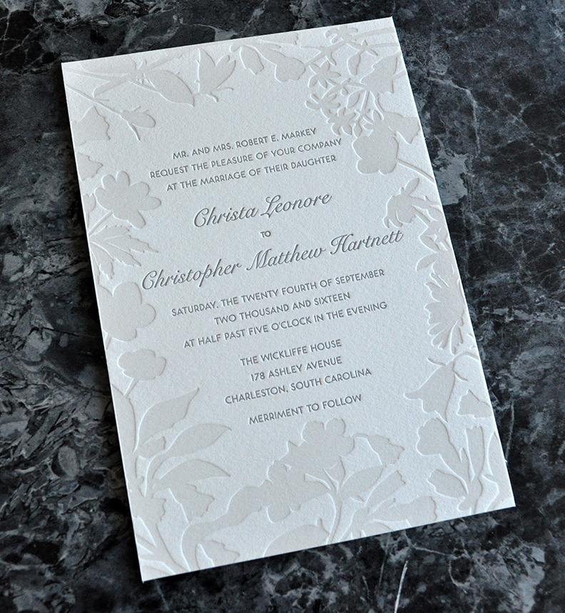 Two-toned grays flower silhouette border letterpress invitation