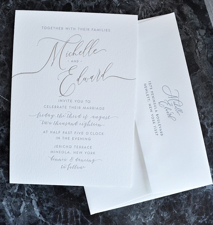 elegant silver foil stamped letterpress wedding invitation with silver edge painting