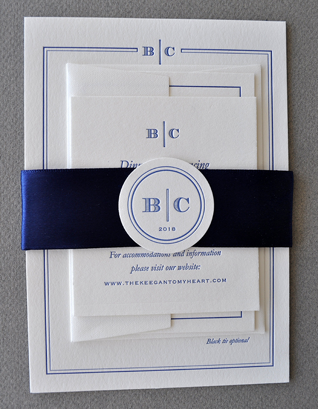 sophisticated letterpress wedding invitation suite in gold