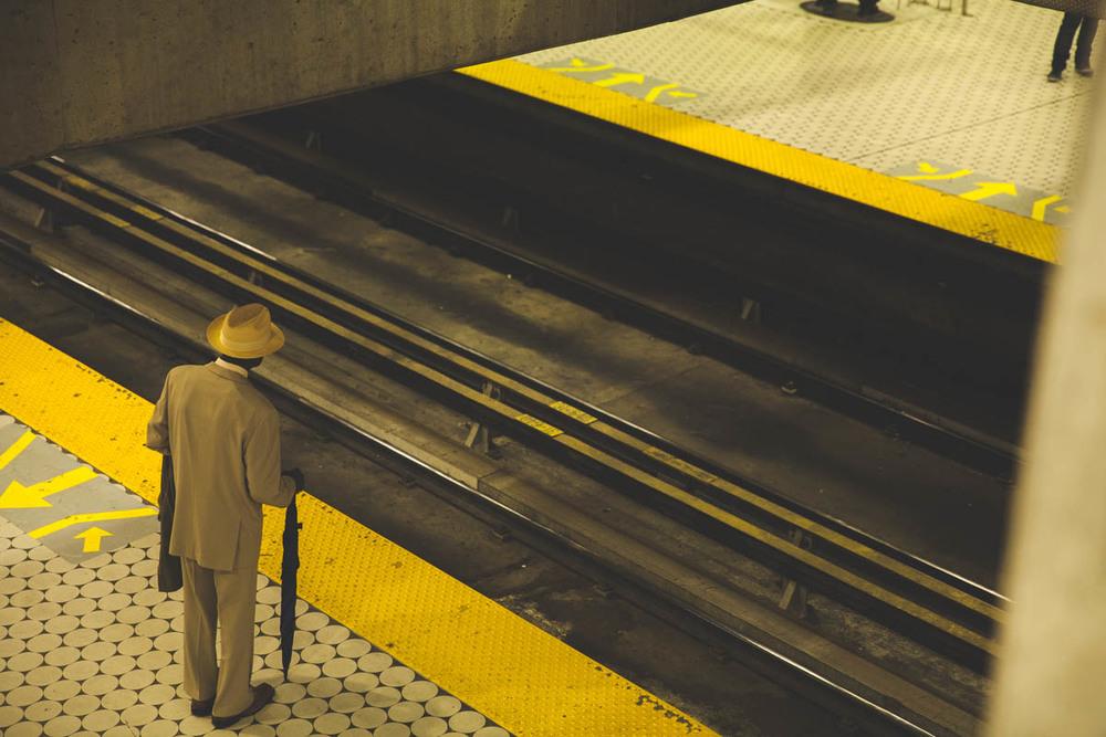 A man waits for the train.
