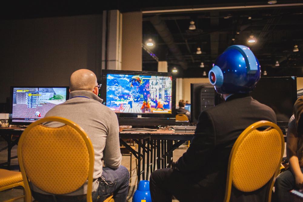 Business Mega Man vs. Average Joe.