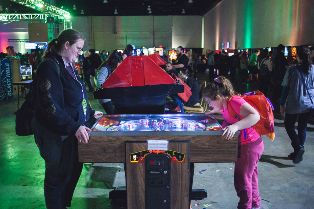 A mother and daughter play head to head pinball