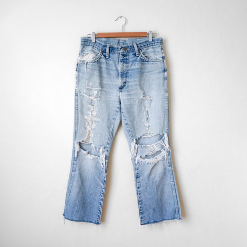 f061f54135 vintage-1980s-rustler-thrashed-denim-jeans-with-patches-