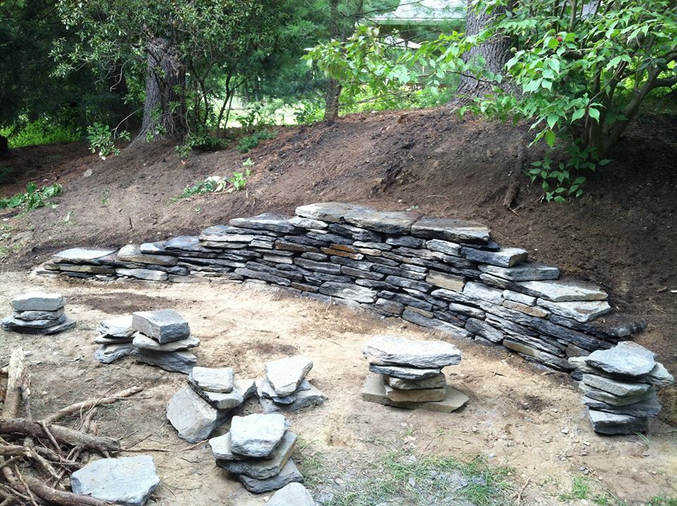 Stone wall under construction.