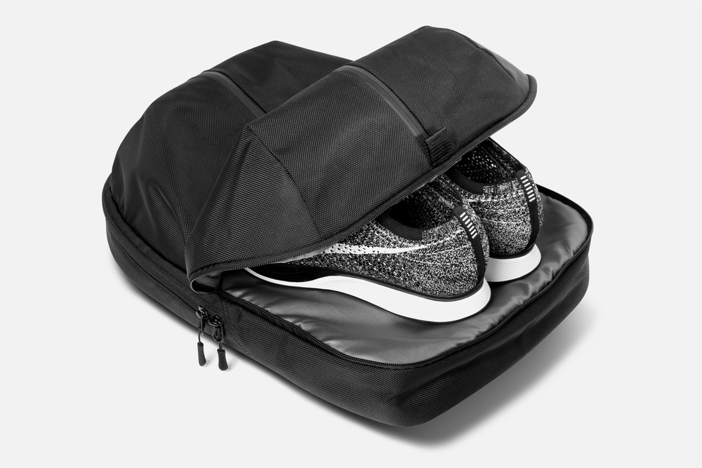6ad934cffbd6 The separate shoe pocket is isolated from the rest of the bag and is lined  with a moisture resistant nylon. The pocket is large enough to fit size 12  men s ...