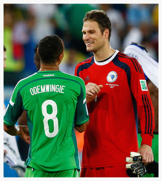 Asmir with Stoke City team-mate Peter after Nigeria beat Bosnia 1-0 in Brazil