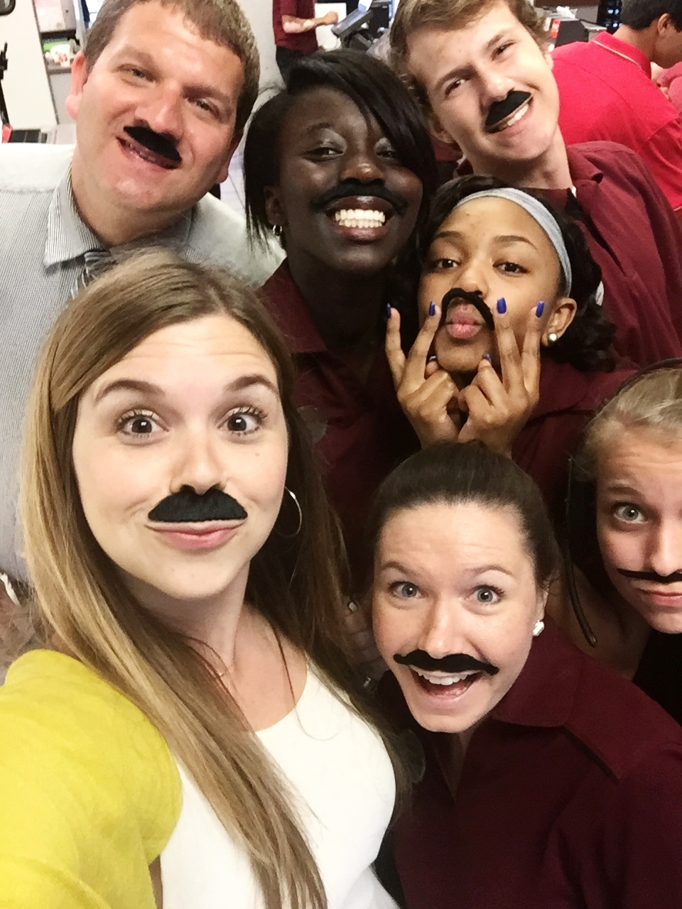 The team sporting mustaches for a promotional event -  Mustache Milkshake Monday.