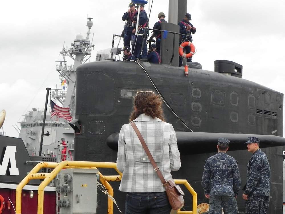 Wife, Katy, stands in front of the submarine moments before her husband goes underway