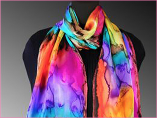 Niki David Silks  - Based in Coloroda, owners Nicole and David Stasinsky craft individually painted silk apparel including scarves and ponchos.