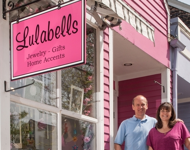 Owners, Susan and Donald Robertson pose in front of their store, Lulabells, in Wickford, Rhode Island.