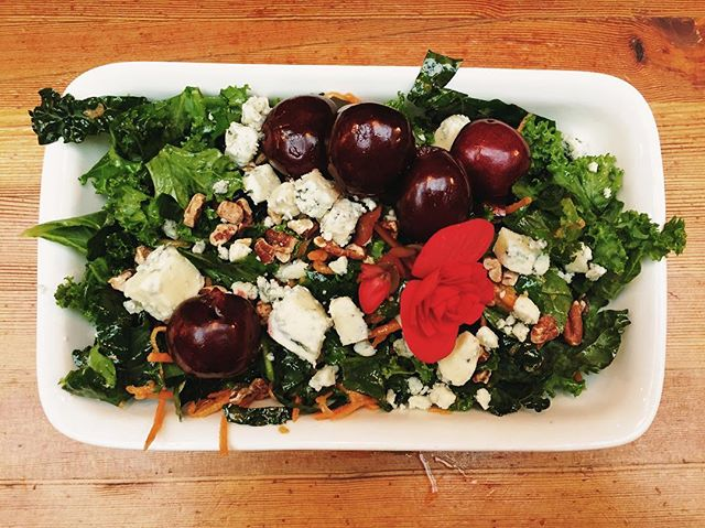 Our Schipper Farm's kale salad with Devil's Rock creamy blue cheese, BC cherries & Boxwood begonias. #boxwoodyyc #yyceats #yycpatio
