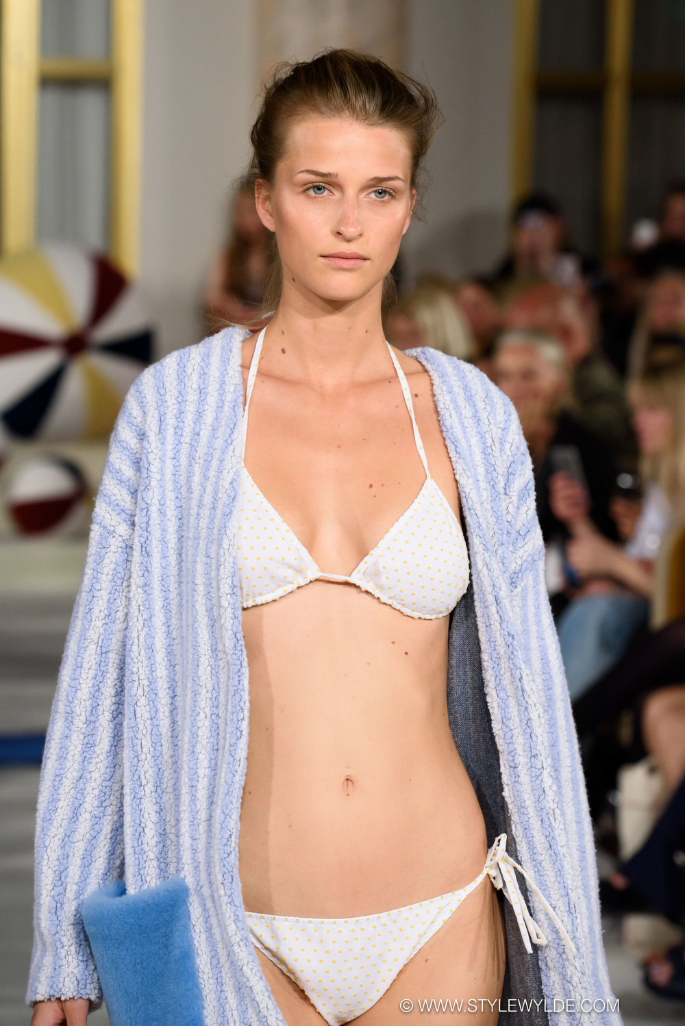 Sexy, but still sweet... - The Anne Vest Spring/Summer 2018 collection was a playful romp from the beach to the office that included a surprising amount of heavy outerwear mixed into the more seasonally expected bikinis and lightweight separates. Fuzzy beachballs appeared as bags, and as details on tops, coats, and sweaters for an added touch of whimsy.