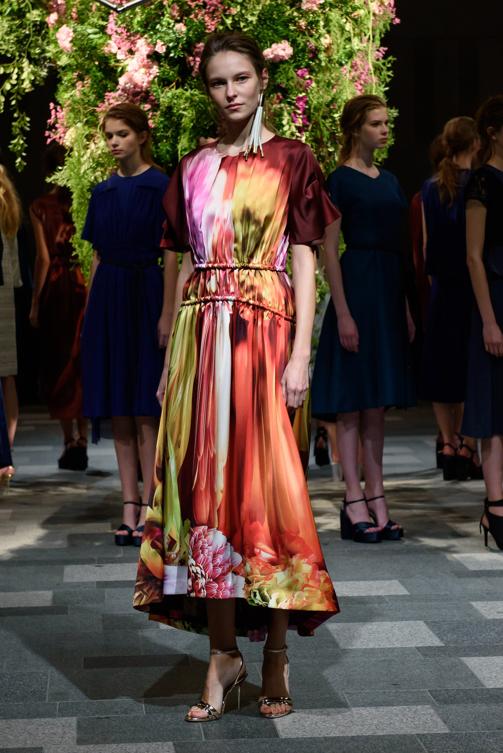 Florabunda - An enormous bouquet of fresh flowers served as an oversized centerpiece as deconstructed floral prints made their way around the runway presentation space at the Hanae Mori Manuscrit Spring 2018 show.