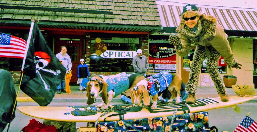APRIL 2011 - Dude's first parade with no eyes.  Elvis, Dude and dog mom Barb Ayers at NW Cherry Festival in The Dalles.                                     Photo: (c) Barb Ayers, DogDiary.org
