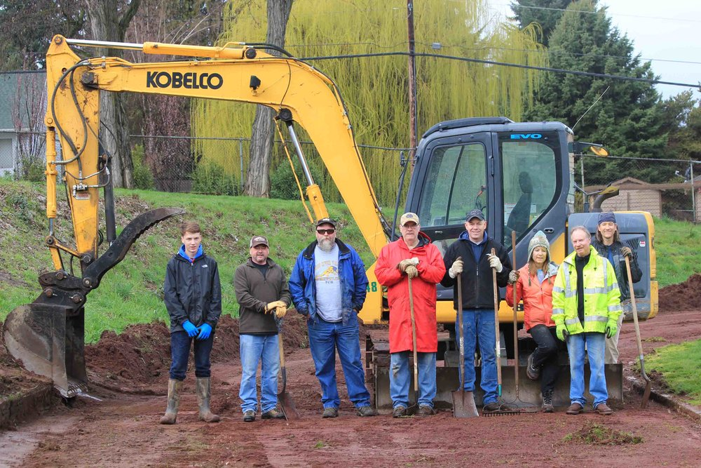 Hood River Rotary service project at Hood River Middle School 2016 - cleaning up the track. That's me, Barb, on the right - the girl.         Photo: Michael McElwee